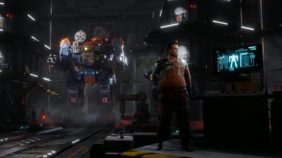 a man stands next to a big mech in a repair bay
