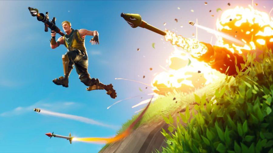 Ein Mann und seine Raketen springen von einer Klippe in Fortnite, einem der besten Multiplayer-Spiele