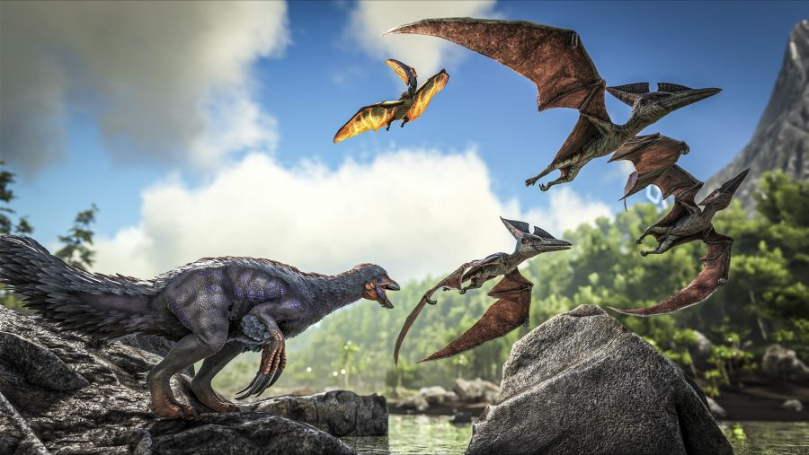 Dinosaurs of all sizes by a rocky lake in one of the best survival games, ARK Survival Evolved