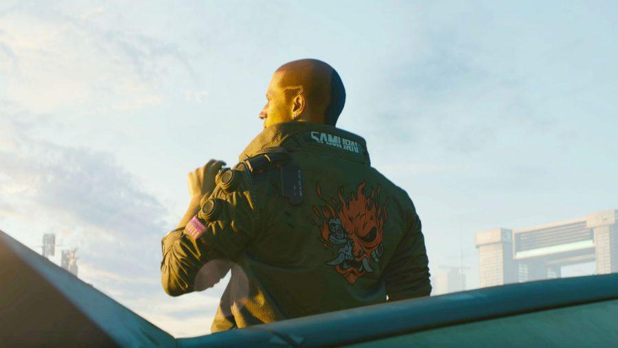The Cyberpunk 2077 protagonist V shows off their samurai jacket in Cyberpunk 2077, one of the best cyberpunk games