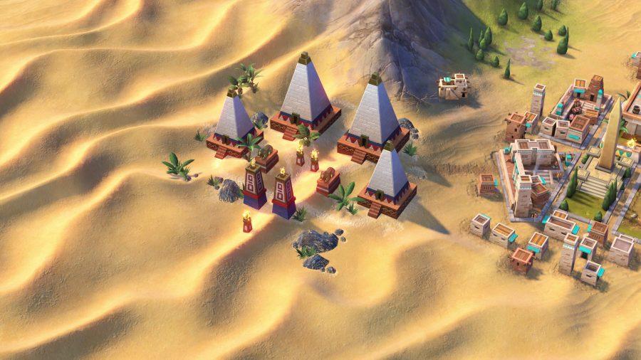 some nubian buildings sitting on a desert tile