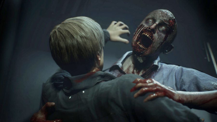 A zombie with its mouth wide open in the Resident Evil 2 remake, one of the best zombie games
