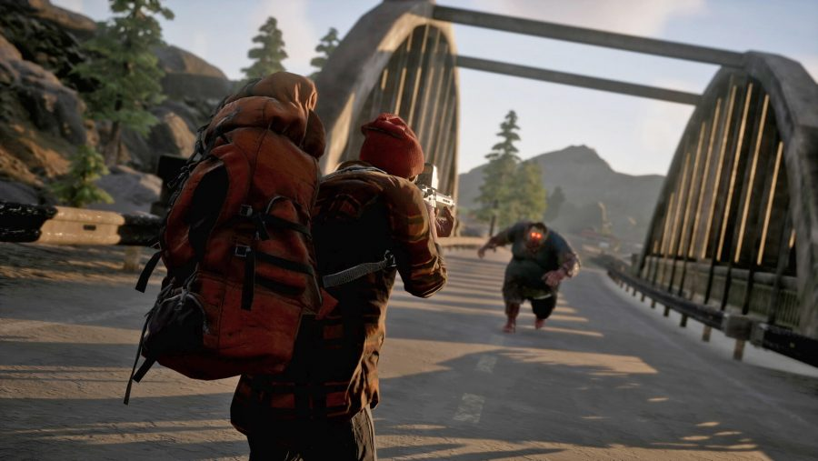 A massive zombie comes barrelling down a bridge in one of the best zombie games, State of Decay 2