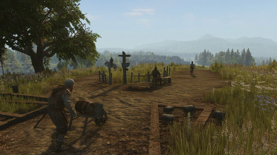 A man carts a wheelbarrow towards a crossroads in one of the best new MMOs, Life is Feudal