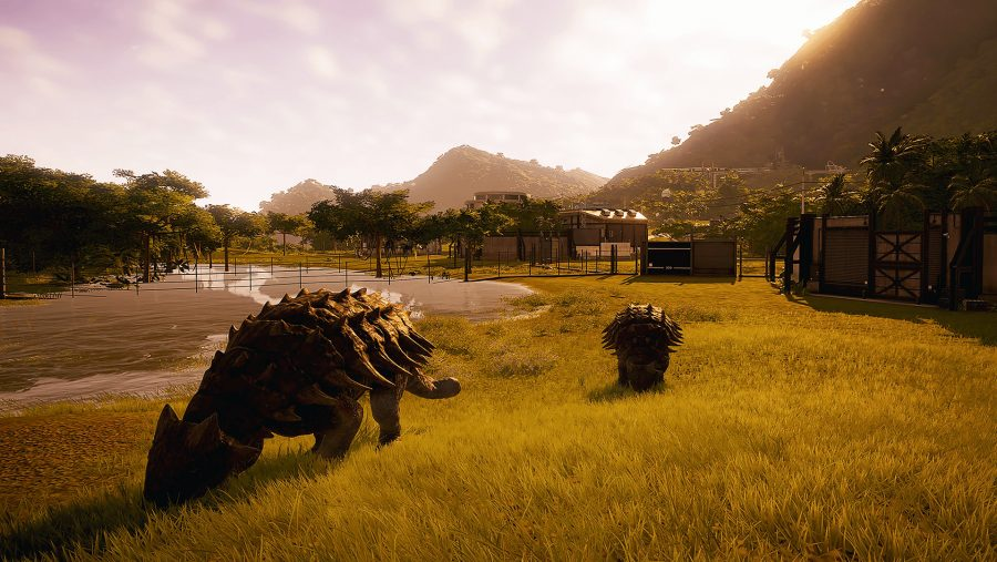 Dinosaurs peacefully grazing in one of the best management games, Jurassic World Evolution