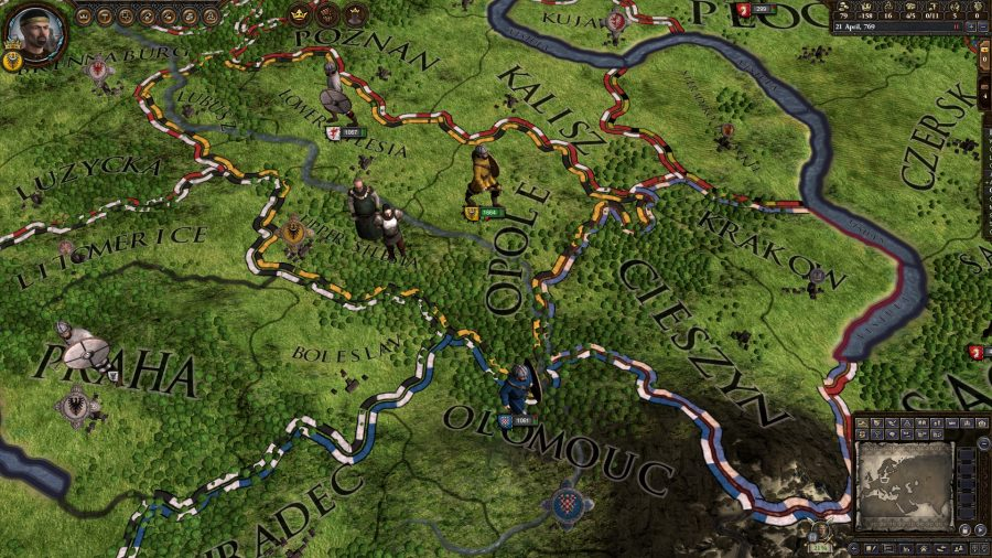 The player's map is focused around Krakow. Various units from different nations are milling around, while some peasants stand there looking worried about their future.